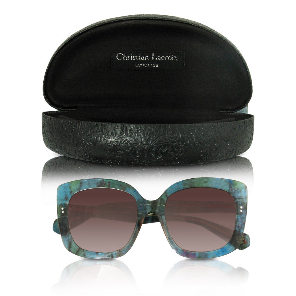 Jackie O like Christian Lacroix sunglasses