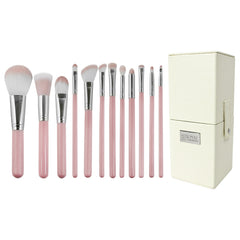 Love Is... Kindness™ – 12-piece Brush Kit - makeup brushes lined up side-by-side next to brush kit box