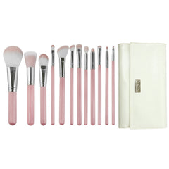 Love Is... Kindness™ – 12-piece Wrap Kit - makeup brushes lined up side-by-side next to brush wrap