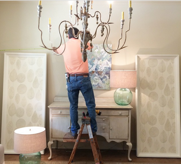 One of our favorites (and lifesaver on many installs :) ), Steve, hanging some beautiful pieces for the show house!