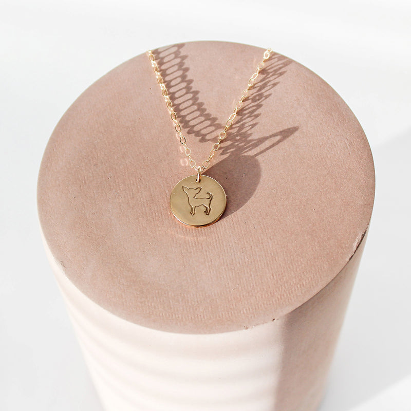 Coin necklace with a chihuahua stamped on piece that is composed of sterling silver, 14kt gold filled or 14kt rose gold filled