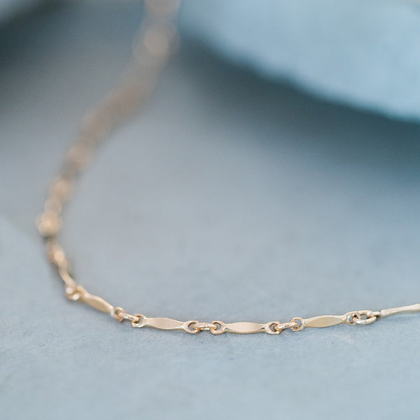 This gold choker is dashing and perfect for layering.