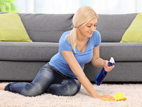 Women Cleaning Carpet