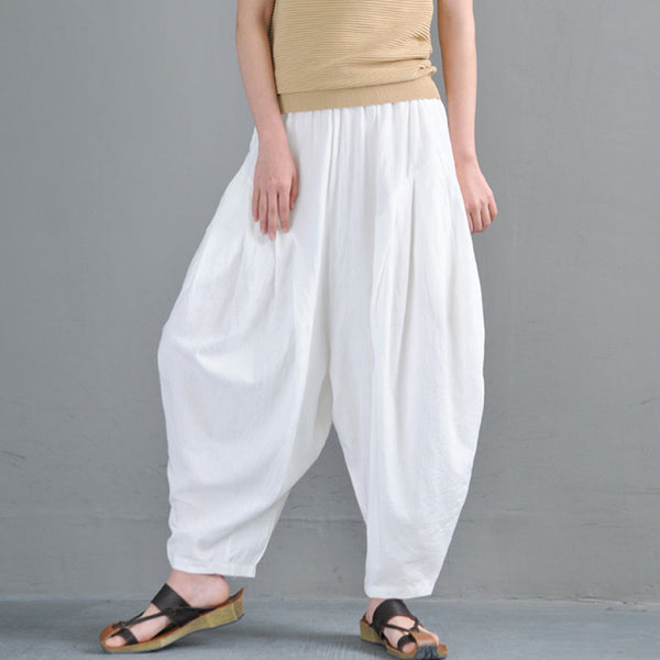 Women White Ankle-Length Pleated Loose Pants - Buykud