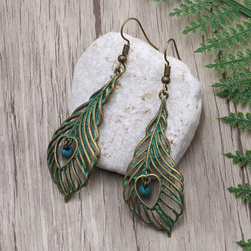 Women Retro Plating Hollow Leaf Earrings