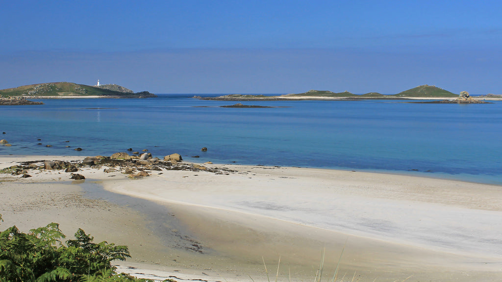 Looking over Treco beach to Round Island lighthouse, Isles of Scilly