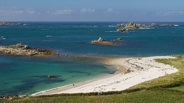 Looking over Rushy Bay on Bryher to Northern or Norrard Rocks, Isles of Scilly