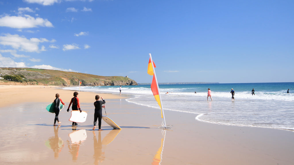 Surfers at Praa Sands beach, West Cornwall