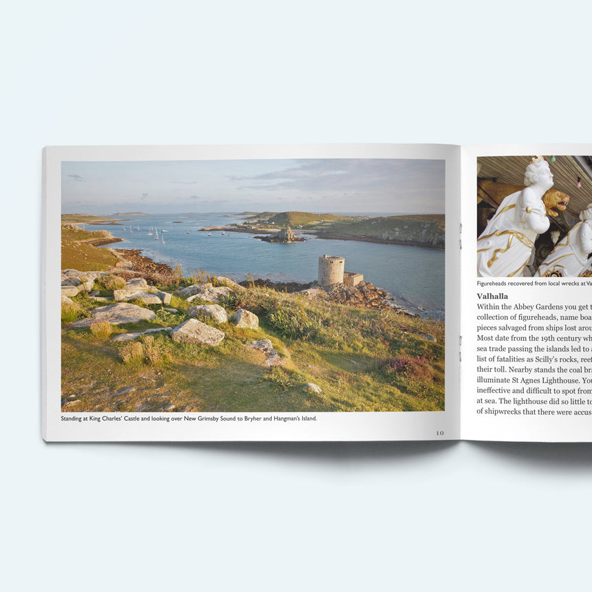 Pages from our Scilly Island by Island book on Tresco looking from King Charles' Castle over Cromwell's Castle towards Bryher. The facing page shows a figureheads from wrecked ships on display at Valhalla Musueum in the Abbey Gardens.