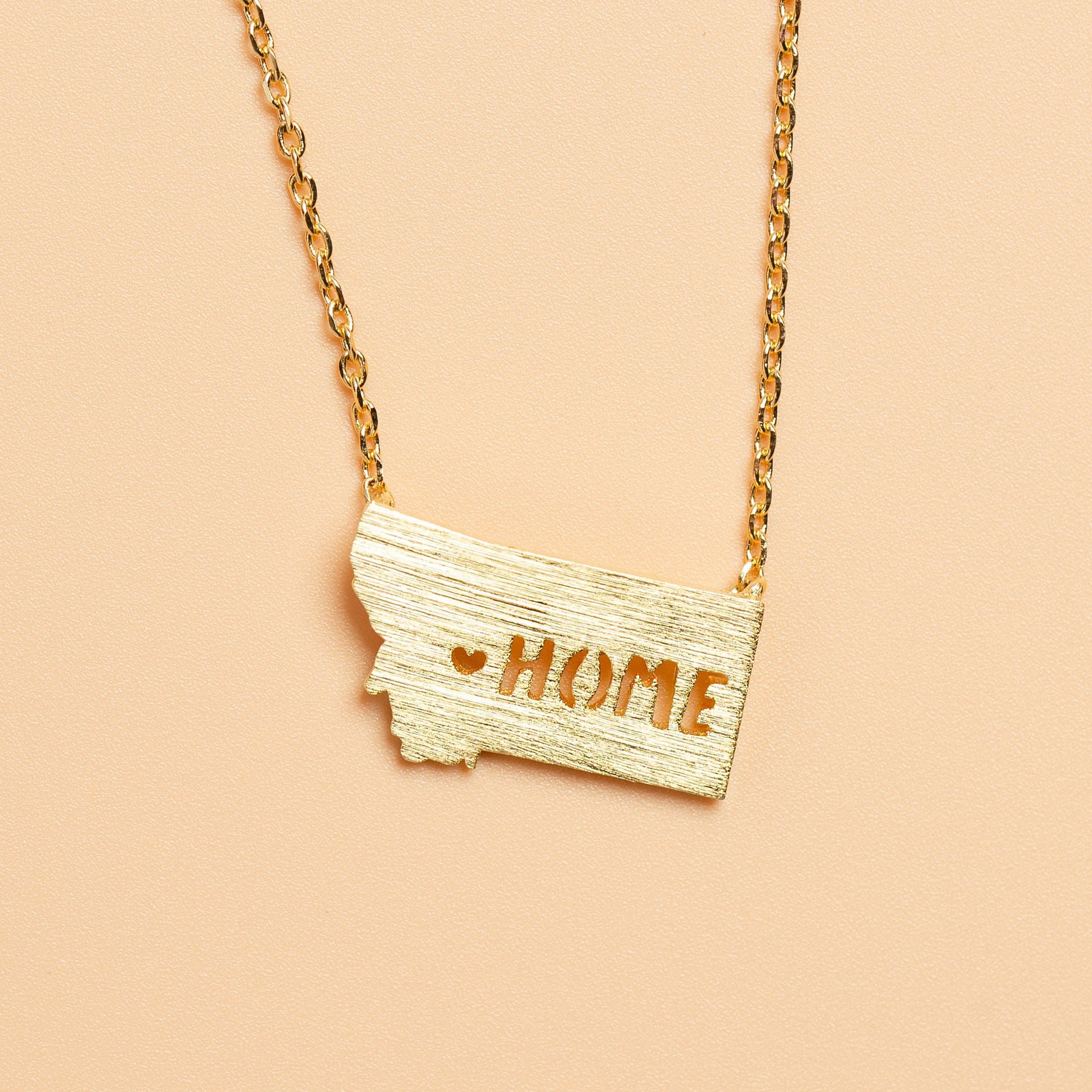 All Hearts Go Home Necklace in Gold