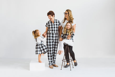 womens black white check jumpsuit and girls pinafore