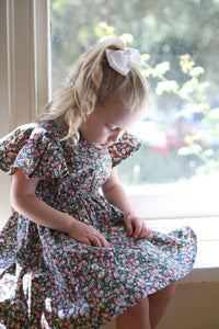Girls floral dress, girl wearing floral dress