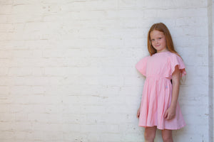 Girls pink dress, girl wearing pink dress
