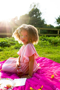 Girls pink dress, girl wearing pink dress sitting on rug
