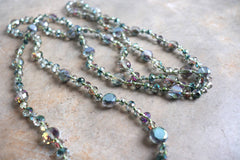 Glitze and Glamour Necklace - Stunning luxe-length, hand-knotted necklace made with faceted glass beads in a rainbow metallic finish.