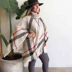 Highlander Women's Poncho with fringed edging with plaid patterning. No itch acrylic knit, available in a range of colours.