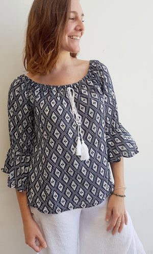 Womens light 100% rayon peasant style 'Casablanca' summer blouse with circular flounce 3/4 sleeve, elastic neckline + tassel tie feature on front. Navy + white Ikat print.
