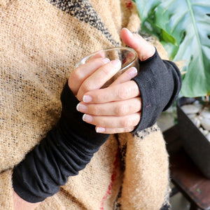Finger-less winter warmers made with a stretchy cotton knit. Long mitts that are great for staying warm while keeping fingers free. Long Black