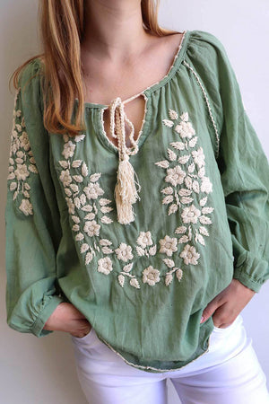 Handcrafted cotton blouse with beautiful detail cotton embroidery. Soft pastels and classic navy and white colours. Kobomo.