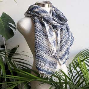 Hand-woven 100% cotton scarf, made with raw cotton and natural dyes. Measures 46cm x  168cm perfect for your winter wardrobe.. Navy + Cream + Silver.