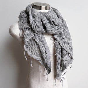 Hand-woven 100% cotton scarf, made with raw cotton and natural dyes. Measures 46cm x  168cm perfect for your winter wardrobe.. Silver.