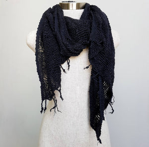 Hand-woven 100% cotton scarf, made with raw cotton and natural dyes. Measures 46cm x  168cm perfect for your winter wardrobe.. Black.