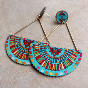 Carnivale Earrings in light wood with a festive design. Available in turquoise blue and red