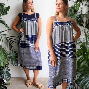 Long, two-toned women's sun dress with diagonal stripes. One size below the knee summer dress made from soft rayon fabric with adjustable shoestring straps. Fitting sizes 10-18+.