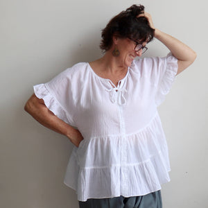 Flowing free size white cotton blouse perfect for our hot Australian summer season. Plus size style.