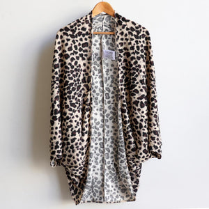 One-size open cardi in an animal themed print. Designed with a luxe feel and a generous cut to fit all sizes. Ethically hand cut + sewn.