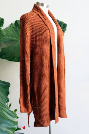 Classic winter style, long length cardigan, made with easy care acrylic fibre. Copper.