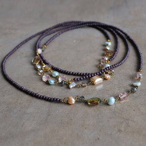 Long strand necklace that can be layered up to 3 times around.  Handmade in all glass beads with baroque pearl highlights.