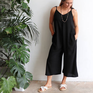 In Cahoots Jumpsuit - Classic black overalls designed for small to plus sizes. Pockets view.