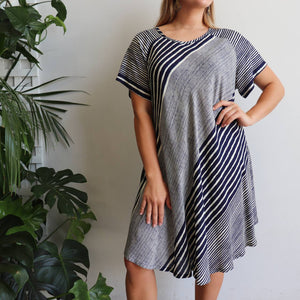 Womens one-size Sun Dress, a perfect short sleeved beach dress in a vibrant stripe print,  Featuring an A-line cut and scalloped hemline falling around the knees.  Navy.