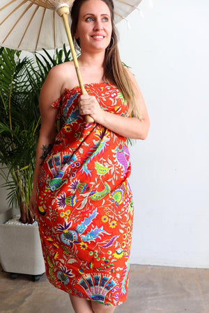 Women's resort style summer beach holiday sarong for cover up or picnic must-have. Funky bright essential can be worn as a tunic dress or skirt, so versatile with generous volume to fit plus size ladies - Orange