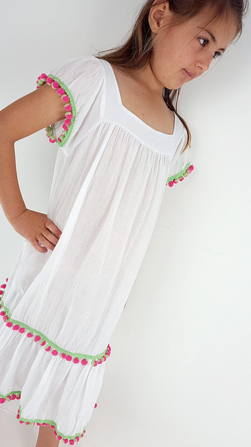 Lightweight little girls peasant style Summer frock with pom pom detailed hem. White. Size for 1yo - 10yo.