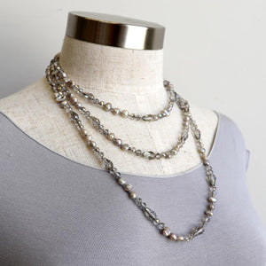 Freshwater pearls and cut glass beads. Hand knotted. 155cm full length. Silver.