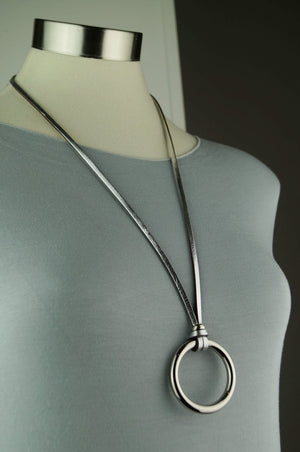 Silver leather medium necklace with metal ring pendant.