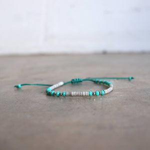 Fine stone and cut glass beaded bracelet. Handmade with knotted slide fastener. Aqua.