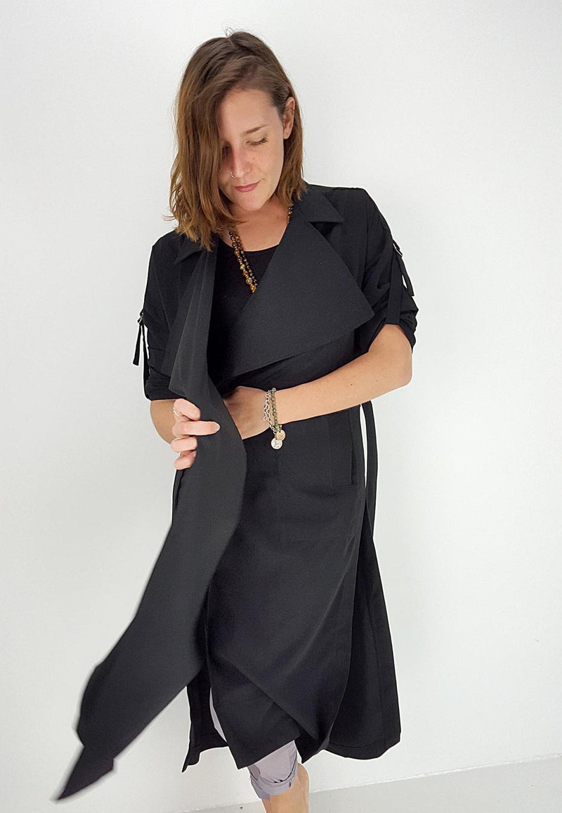 Long Winter trench jacket coat with wide collar, side splits + waist tie. Black.