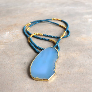 Stunning glass and stone statement necklace with gold metallic hightlights. Marine Blue.