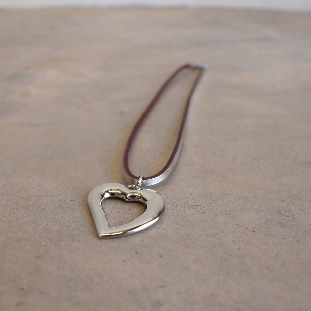 Heart shaped silver pendant combined with a natural leather band available in 3 colours, Black, Silver and Tan