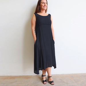 The Abbey Road Dress is a sweeping, midi-length skirted dress with flattering empire line bust. Black.