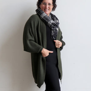 Akakura Batwing Cardigan is a winter knit jacket. Khaki Green. Side View.
