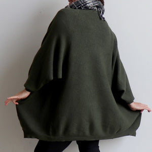 Akakura Batwing Cardigan is a winter knit jacket. Khaki Green. Back view.