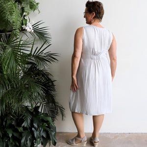 All Season Pocket Smock Dress is a sleeveless, knee-length tunic dress in linen blend fabric. Available in sizes 8 to 20.
