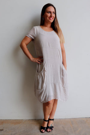 All Seasons Pocket Smock Dress with short sleeves in neutral moonshine colour cotton blend fabric.