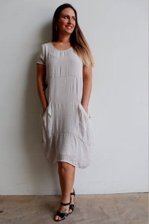 All Seasons Pocket Smock Dress with short sleeves in neutral moonshine colour cotton blend fabric. Plus size available
