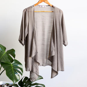 Lightweight Summer cardigan top. 'Any-which-way' semi-sheer fabric true to size buttoned cover-up. Sizes 8-22. Stone.