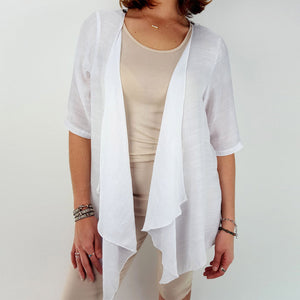 Lightweight Summer cardigan top. 'Any-which-way' semi-sheer fabric true to size buttoned cover-up. Sizes 8-22. White.